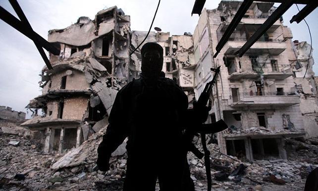 Ankara, Suriye'de ölen isyancıların ailesine Türkiye'de ev sözü verdi